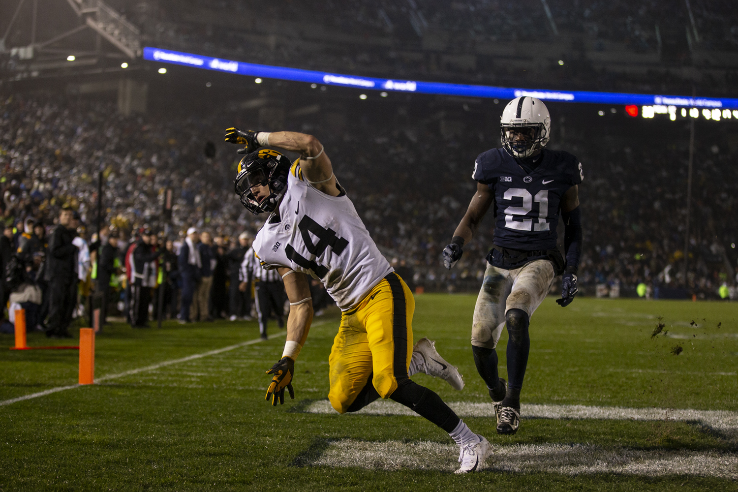 Iowa wide receiver Kyle Groeneweg (14) trips as the ball sails over his head and out of bounds during Iowa's game against Penn State at Beaver Stadium on Saturday, October 27, 2018. The Nittany Lions defeated the Hawkeyes 30-24.