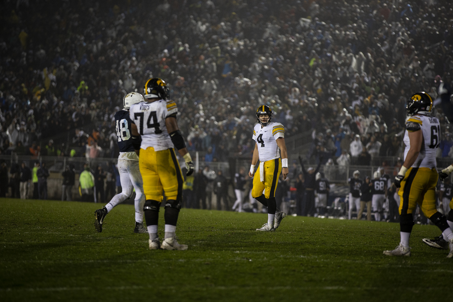 Iowa quarterback Nate Stanley (4) walks off the field after throwing an interception during Iowa's game against Penn State at Beaver Stadium on Saturday, October 27, 2018. The Nittany Lions defeated the Hawkeyes 30-24.