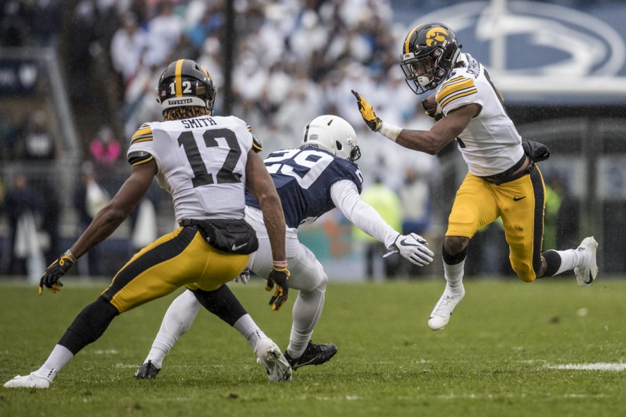 Iowa+wide+receiver+Ihmir+Smith-Marsette+avoids+a+defender+during+Iowa%27s+game+against+Penn+State+at+Beaver+Stadium+on+Saturday%2C+Oct.+27%2C+2018.+The+Nittany+Lions+defeated+the+Hawkeyes+30-24.