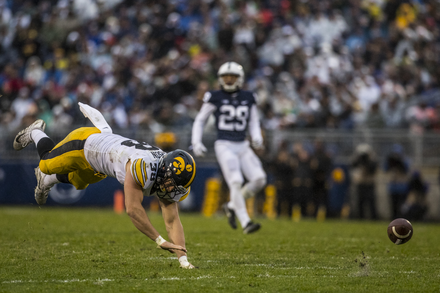 Iowa tight end T.J. Hockenson trips trying to catch up to an overthrown pass during Iowa's game against Penn State at Beaver Stadium on Saturday, Oct. 27, 2018. The Nittany Lions defeated the Hawkeyes 30-24.