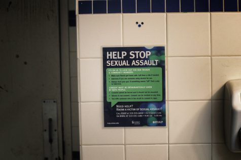 """Signs say, """"Help Stop Sexual Assault"""" in the bathrooms on Wednesday, Sept. 26, 2018."""