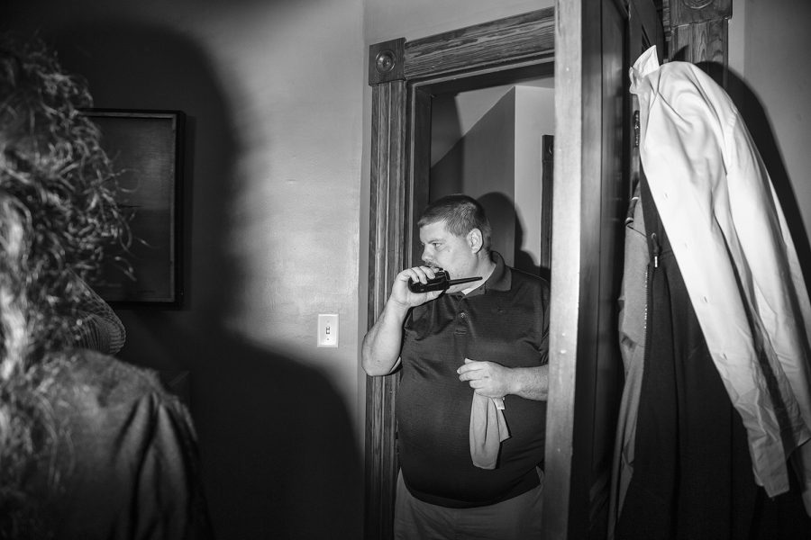 Matthew O'Brien, founder of the Iowa City Ghost Hunters, speaks on the walkie-talkie to his wife, Heather O'Brien, as she ran the base downstairs during an Iowa City Ghost Hunters paranormal investigation on Saturday, Oct. 20, 2018. The master bedroom was a point of heavy investigation because of the owner's reports of feeling something touch his forehead while he sleeps.