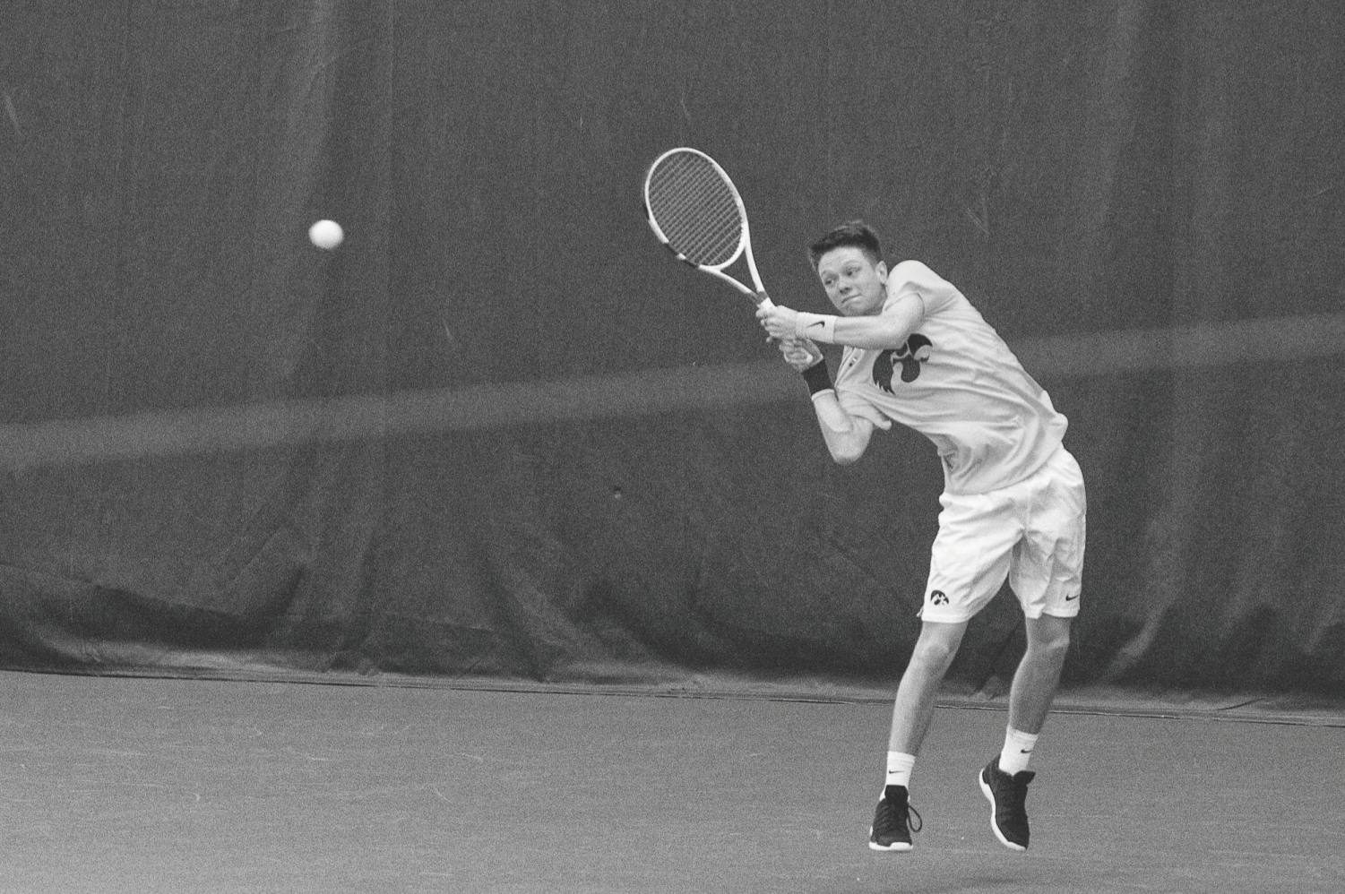 Iowa's Jason Kerst returns the ball against Creighton at the Hawkeye Tennis & Recreation Complex on Feb. 16. The Hawkeyes defeated the Bluejays, 7-0.