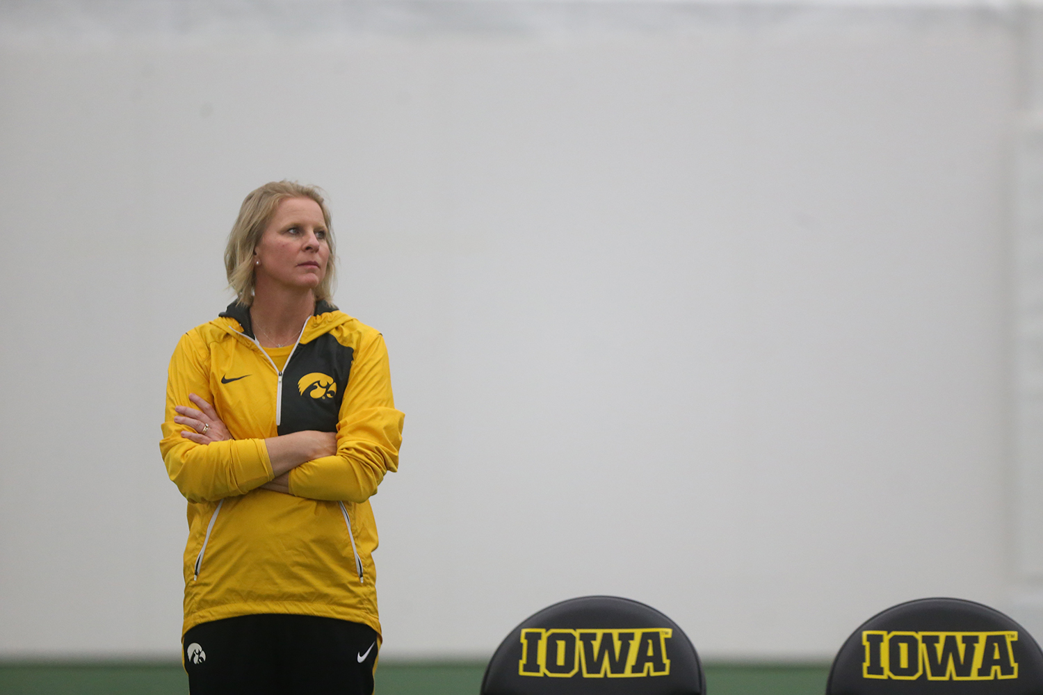 Iowa head coach Sasha Schmid watches a match during the Iowa-Creighton match at the Hawkeye Tennis and Recreation Complex on Saturday, Jan. 21, 2017. The Hawkeyes defeated the Blue Jays, 7-0.