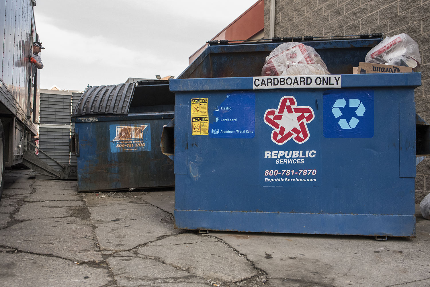 Newly presented cardboard dumpsters are seated behind the Three Towers apartment complex at 313 S. Gilbert St. on Sunday, Jan. 28, 2018. The Iowa City City Council passed a mandate in Nov. 2016 requiring all rental units of four tenants or more to provide recycling services. This resolution will be enforced by the end of 2018.