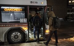 Commuters load and unload busses at the Downtown interchange in Iowa City on Wednesday, Feb. 7, 2018.