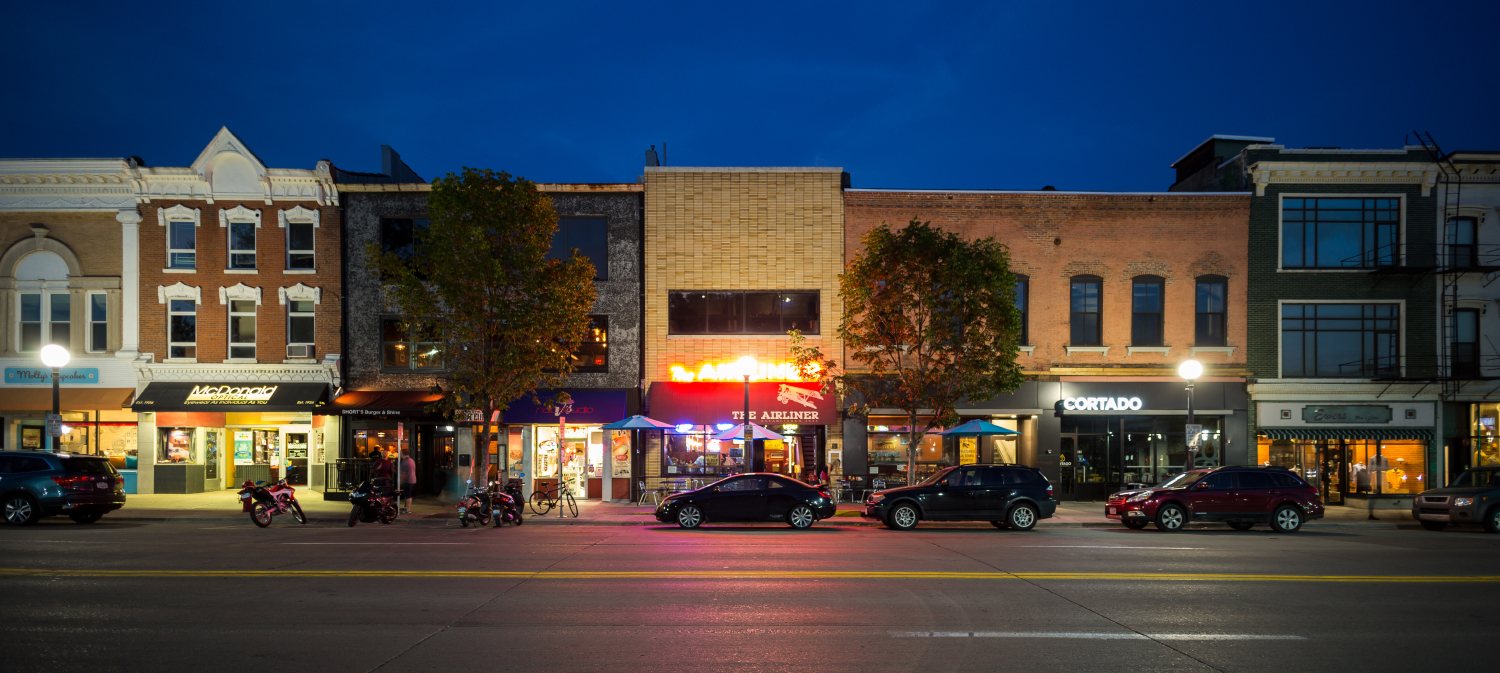 In this composite photo, businesses line Clinton St. in Iowa City on a summer evening. Tuesday, September 12, 2017.