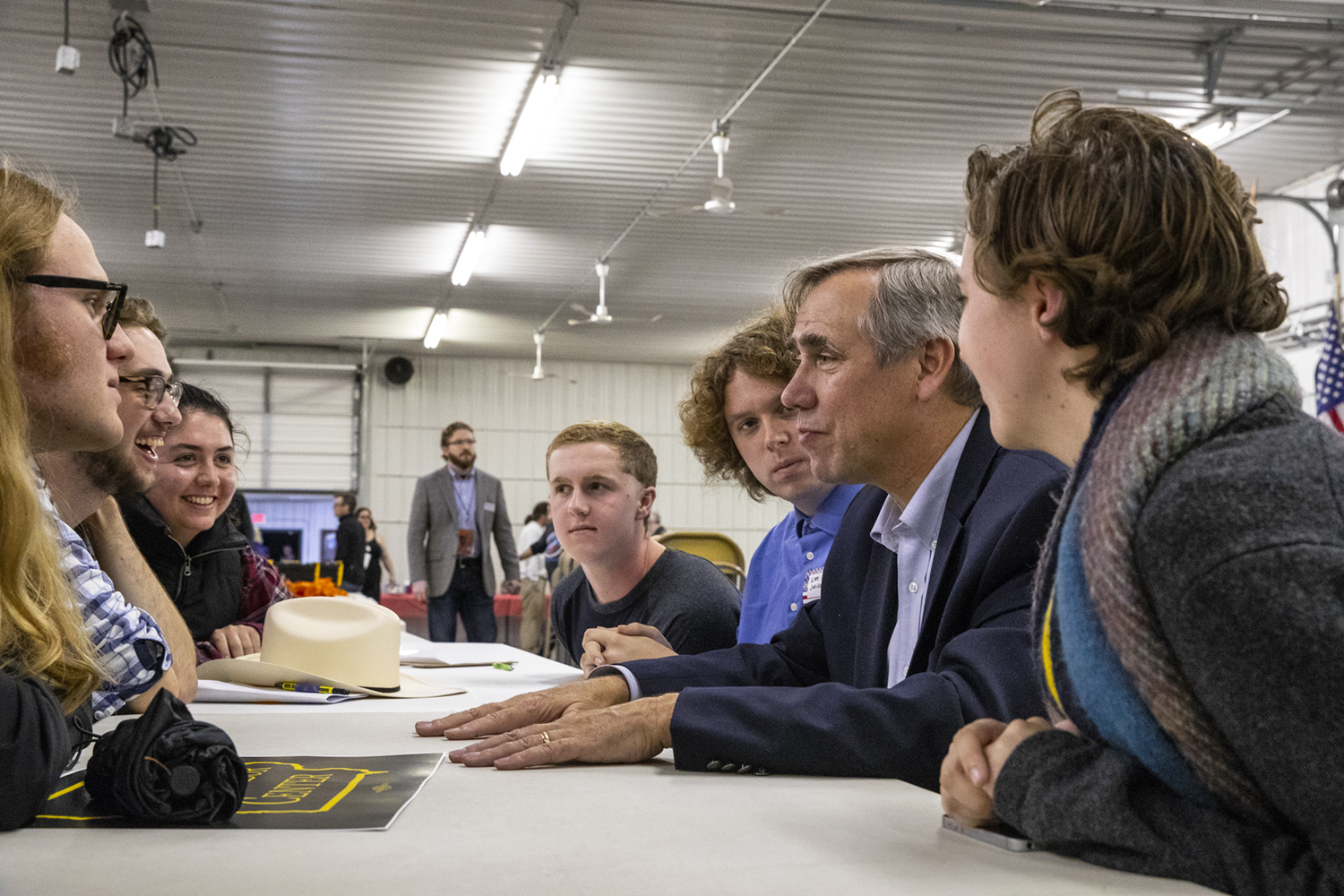 Sen. Jeff Merkley, D—Ore., speaks with the University of Iowa College Democrats at the Johnson County Democratic Party Fall Barbeque. Merkley was part of a collection of both state and national politicians who spoke at the event.