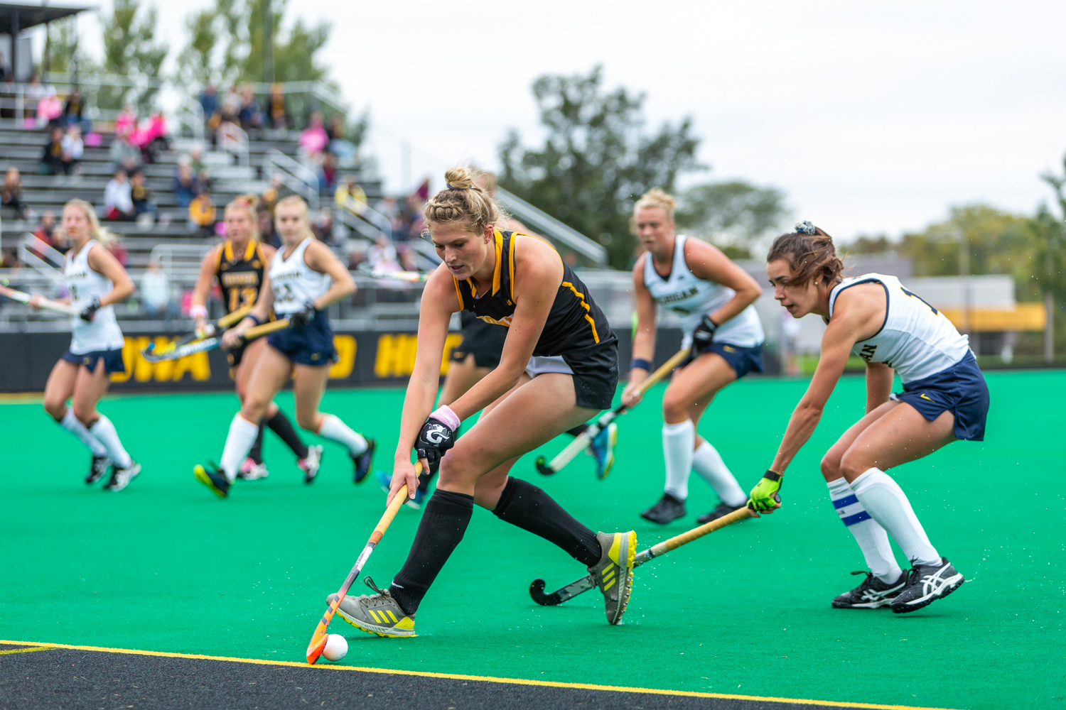 Iowa midfielder Ellie Holley fights to control the ball along the sideline during a field hockey match against Michigan on Friday, Oct. 5, 2018. The no. 6 ranked Wolverines defeated the no. 10 ranked Hawkeyes 2-1.