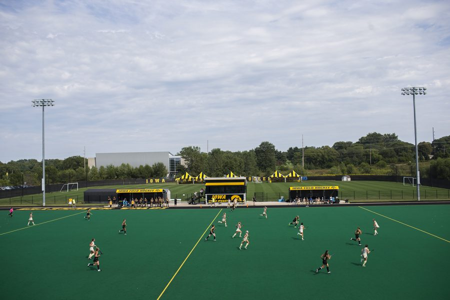 Iowa takes the ball up the field during a field hockey game at Grant Field on Saturday, Aug. 26, 2017. The field is named after Christine Grant, who dedicated her life to advocating for gender equality in college sports.