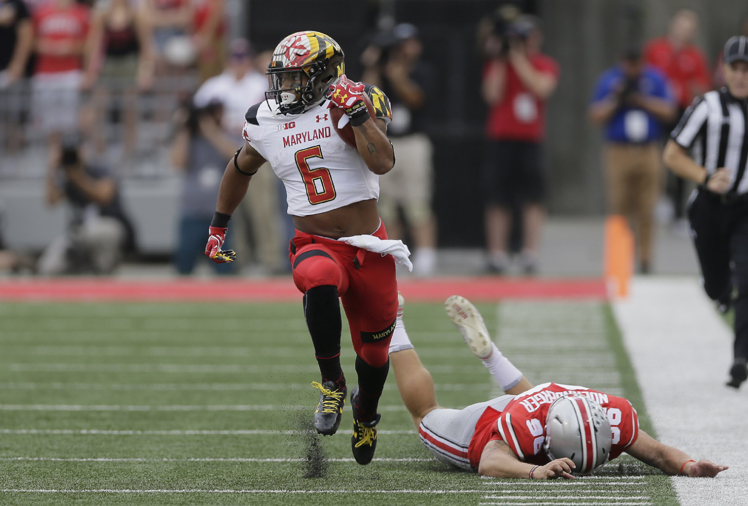 Maryland running back Ty Johnson (6) returns a kickoff 65 yards for a touchdown past Ohio State kicker Sean Nuernberger (96) at Ohio Stadium in Columbus, Ohio, on October 7, 2017.