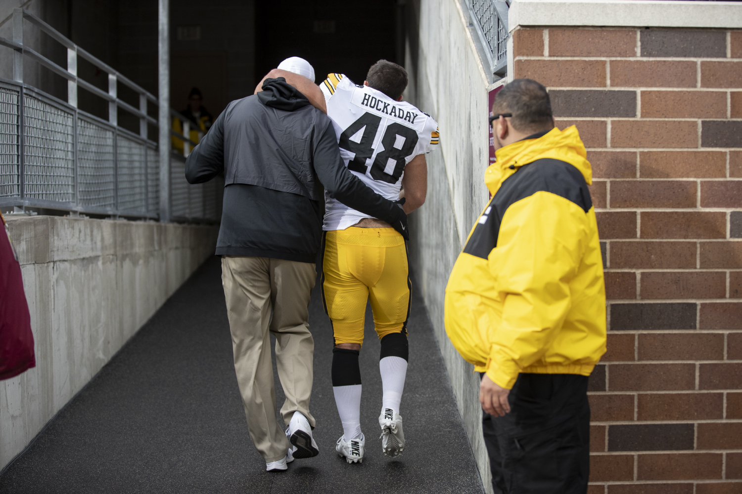 Iowa linebacker Jack Hockaday is helped off the field during Iowa's game against Minnesota at TCF Bank Stadium on Saturday, Oct. 6, 2018. The Hawkeyes defeated the Golden Gophers 48-31.