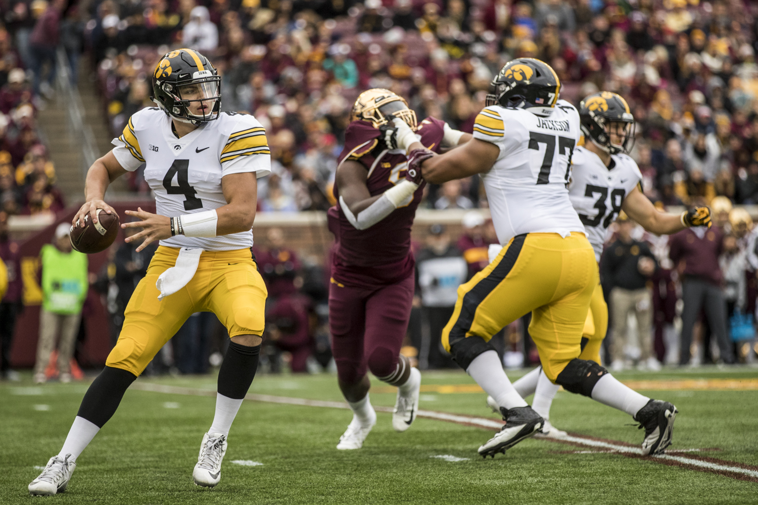 Iowa quarterback Nate Stanley steps into a throw during Iowa's game against Minnesota at TCF Bank Stadium on Saturday, October 6, 2018.