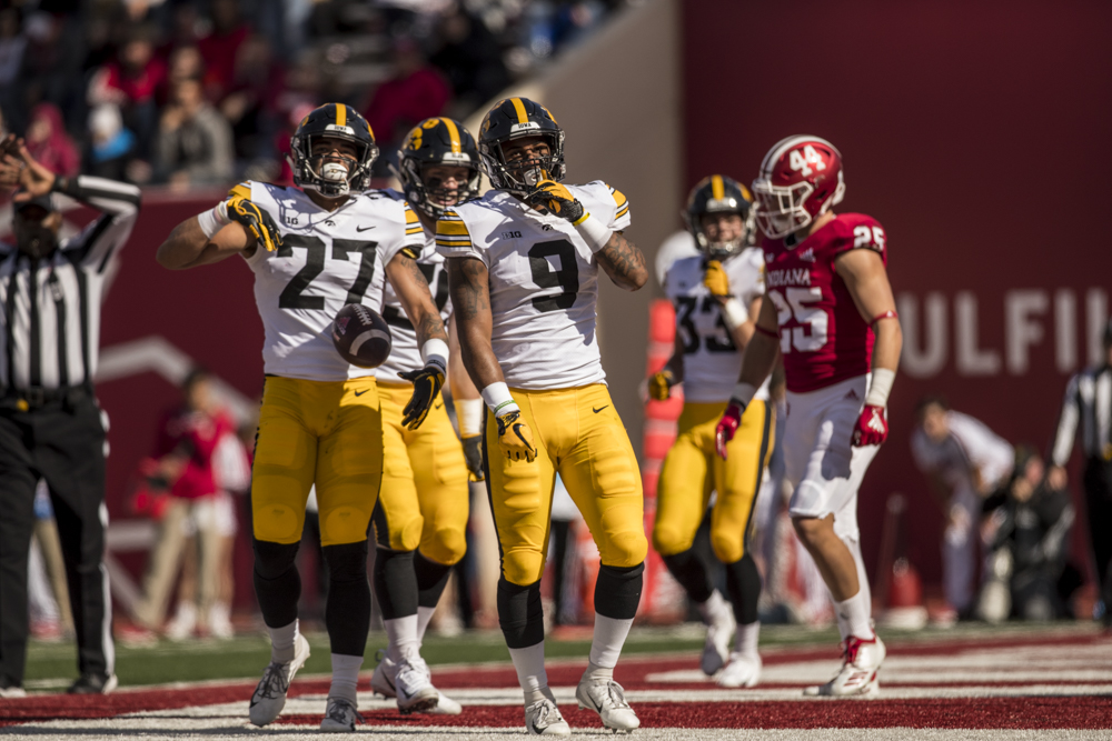 Iowa defensive back Geno Stone celebrates an interception during Iowa's game against Indiana at Memorial Stadium in Bloomington on Saturday, October 13, 2018. The Hawkeyes defeated the Hoosiers 42-16.