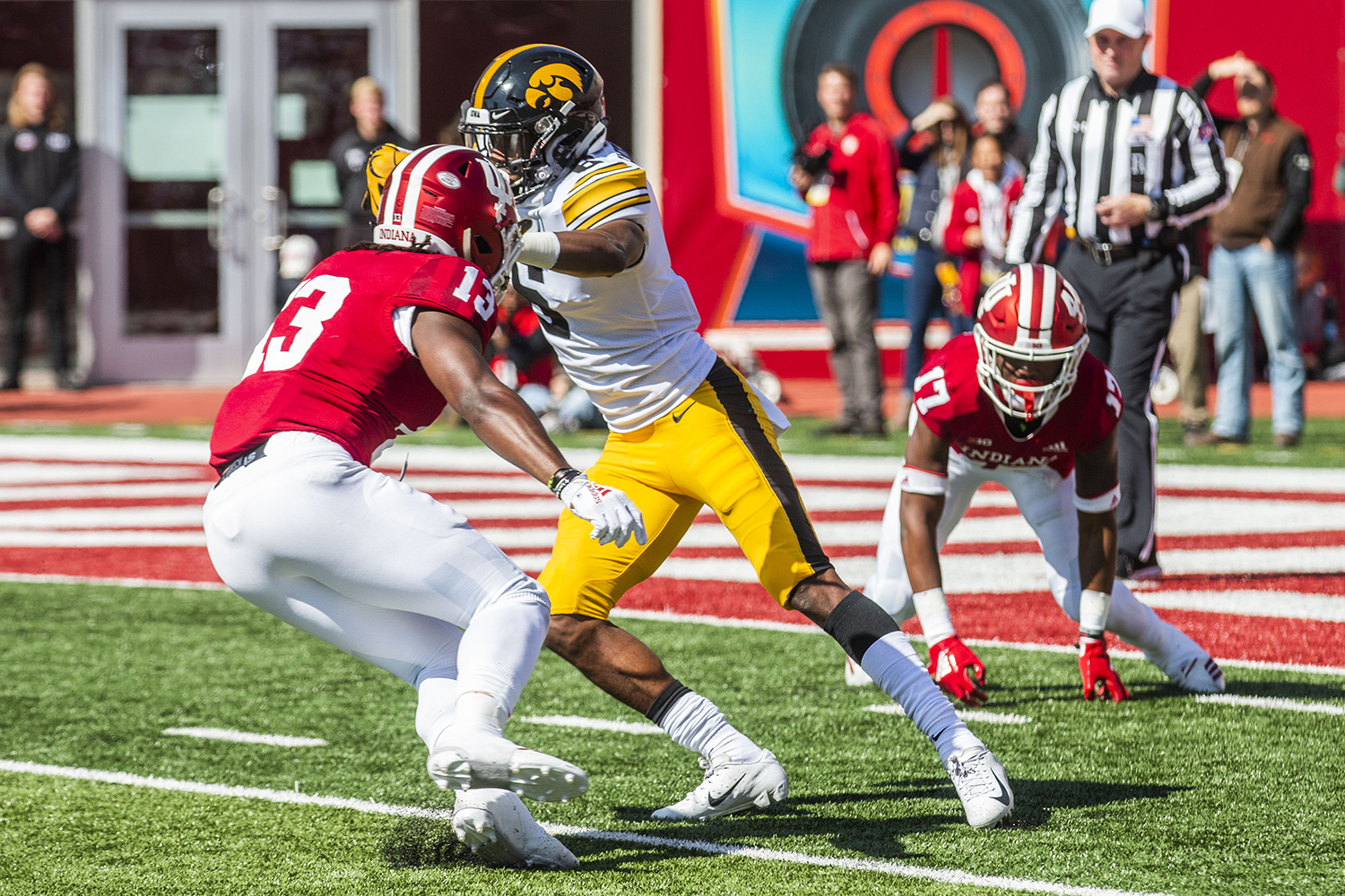 Indiana defensive back Issac James prepares to tackle Iowa wide receiver Ihmir Smith-Marsette during Iowa's game at Indiana at Memorial Stadium in Bloomington on Saturday, October 13, 2018. The Hawkeyes beat the Hoosiers 42-16.