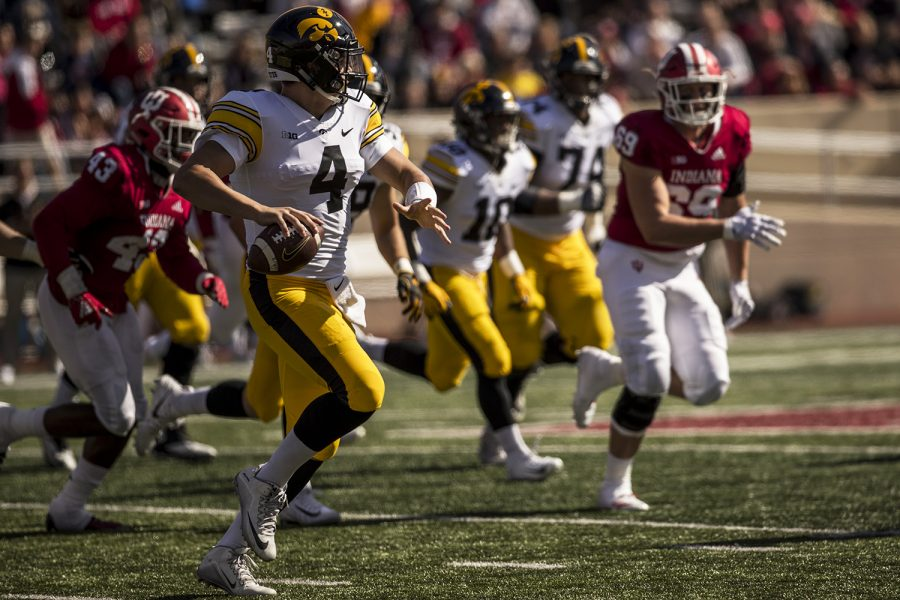 Iowa+quarterback+Nate+Stanley+throws+on+the+run+during+Iowa%27s+game+against+Indiana+at+Memorial+Stadium+in+Bloomington+on+Saturday%2C+October+13%2C+2018.+The+Hawkeyes+defeated+the+Hoosiers+42-16.