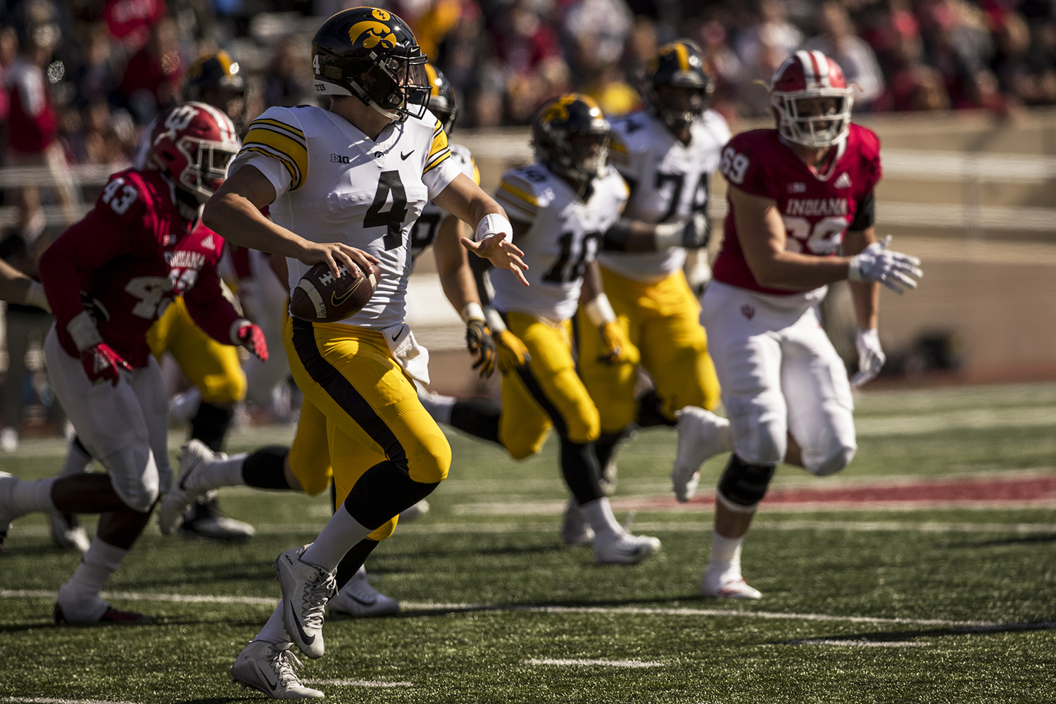 Iowa quarterback Nate Stanley throws on the run during Iowa's game against Indiana at Memorial Stadium in Bloomington on Saturday, October 13, 2018. The Hawkeyes defeated the Hoosiers 42-16.