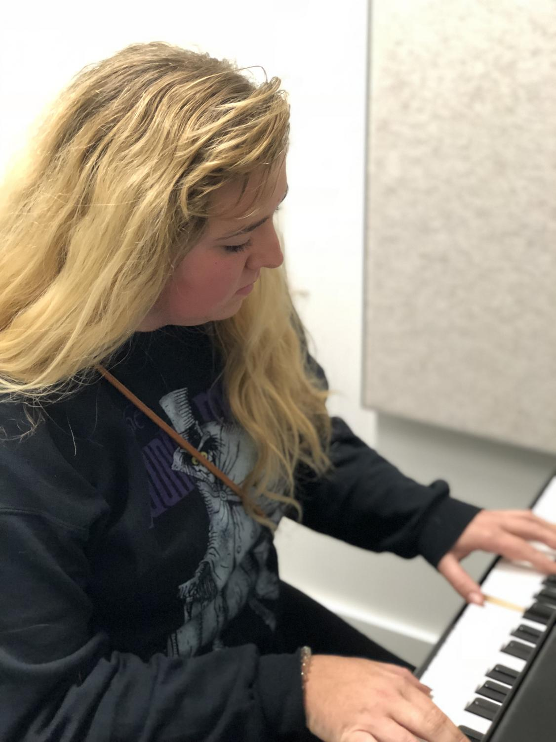Maurice playing piano, one of her several musical specialties.