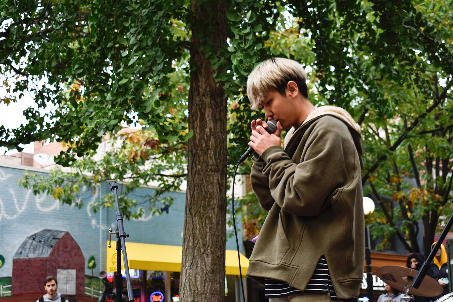 Yusong Ju raps at the University of Iowa Chinese Music Club's outdoor performance at the Iowa City Ped Mall on Saturday, Oct. 13, 2018.