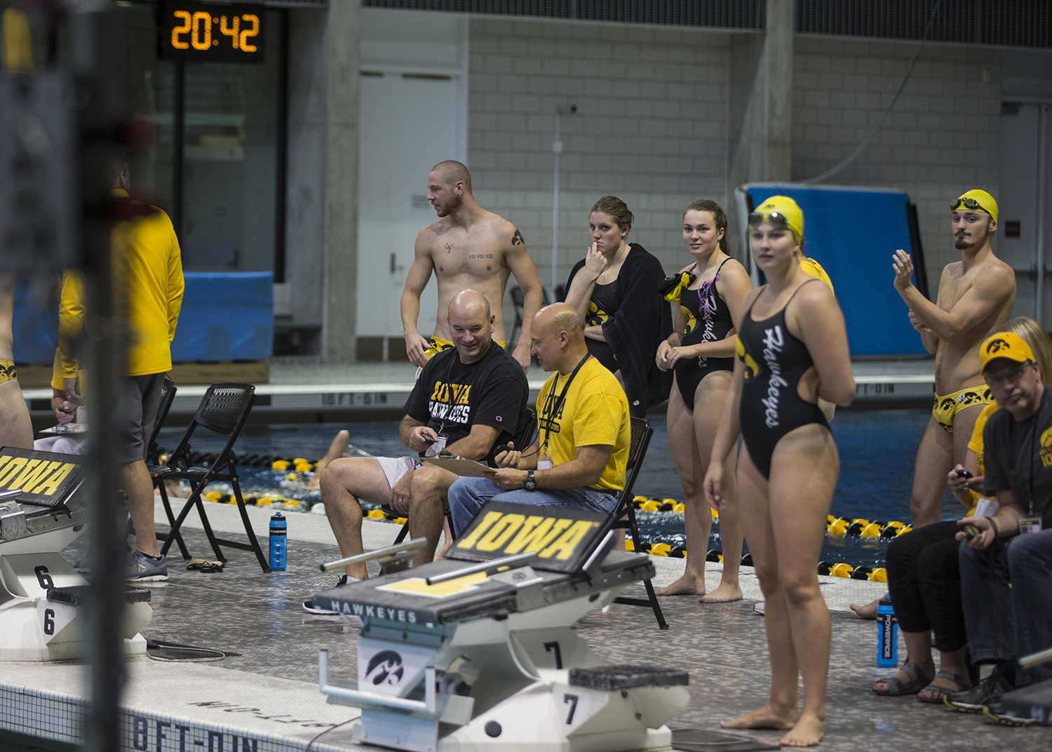 Swimmers look at the scoreboard during the Iowa Swimming and Diving Intrasquad Meet at the Campus Recreation and Wellness Center on Saturday, September 29, 2018. (Shivansh Ahuja/The Daily Iowan)