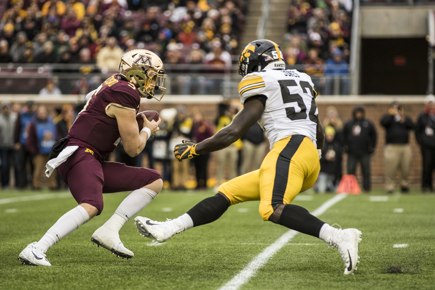 Minnesota+quarterback+Zack+Annexstad+is+pressured+by+Iowa+linebacker+Amani+Jones+during+Iowa%27s+game+against+Minnesota+at+TCF+Bank+Stadium+on+Saturday%2C+October+6%2C+2018.+The+Hawkeyes+defeated+the+Golden+Gophers+48-31.