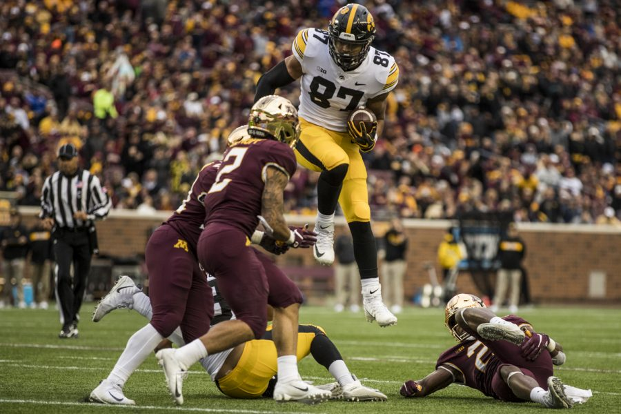 Iowa+tight+end+Noah+Fant+hurdles+a+defender+during+Iowa%27s+game+against+Minnesota+at+TCF+Bank+Stadium+on+Saturday%2C+Oct.+6%2C+2018.+The+Hawkeyes+defeated+the+Golden+Gophers+48-31.