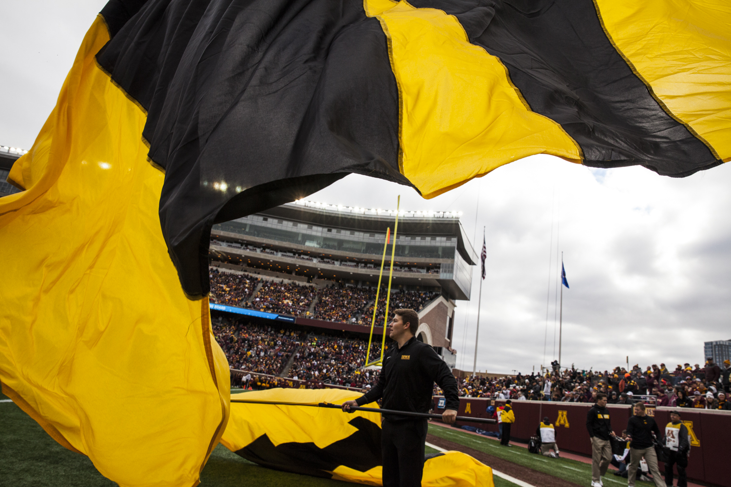 A+member+of+the+Iowa+spirit+squad+waves+a+flag+during+Iowa%27s+game+against+Minnesota+at+TCF+Bank+Stadium+on+Saturday%2C+October+6%2C+2018.+The+Hawkeyes+defeated+the+Golden+Gophers+48-31.
