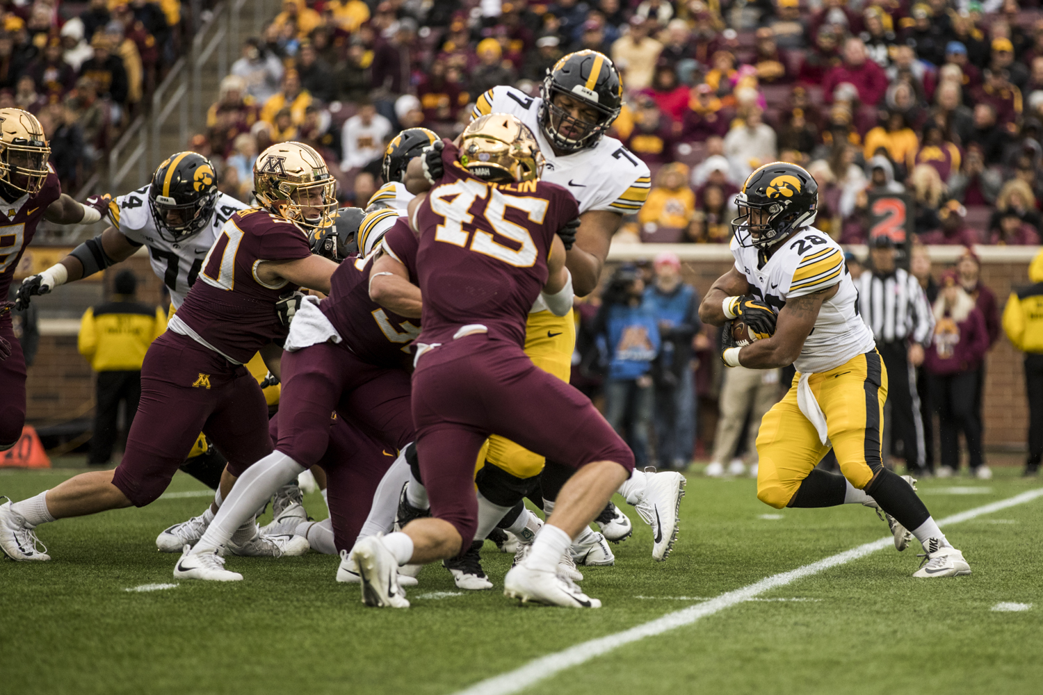 Iowa+running+back+Toren+Young+carries+the+ball+during+Iowa%27s+game+against+Minnesota+at+TCF+Bank+Stadium+on+Saturday%2C+October+6%2C+2018.+The+Hawkeyes+defeated+the+Golden+Gophers+48-31.
