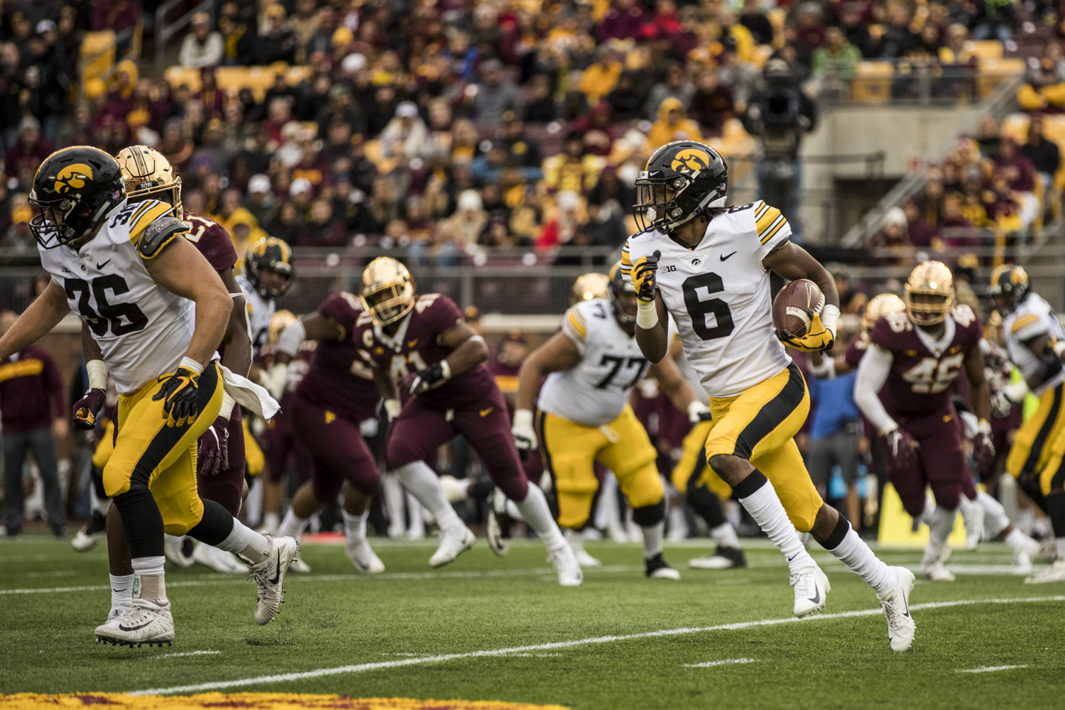 Iowa+wide+reciever+Ihmir+Smith-Marsette+carries+the+ball+during+Iowa%27s+game+against+Minnesota+at+TCF+Bank+Stadium+on+Saturday%2C+October+6%2C+2018.+The+Hawkeyes+defeated+the+Golden+Gophers+48-31.