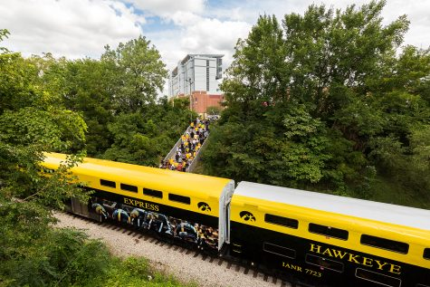 Fans walk up the steps to Kinnick Stadium after alighting from the Hawkeye Express before a football game against Miami (Ohio) on Sept. 3, 2016.