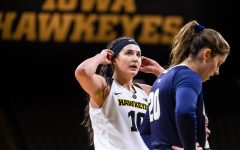 Iowa forward Megan Gustafson #10 adjusts her headband during a break in play during a women's basketball game against Oral Roberts University on Friday, Nov. 9, 2018. The Hawkeyes defeated the Golden Eagles 90-77.