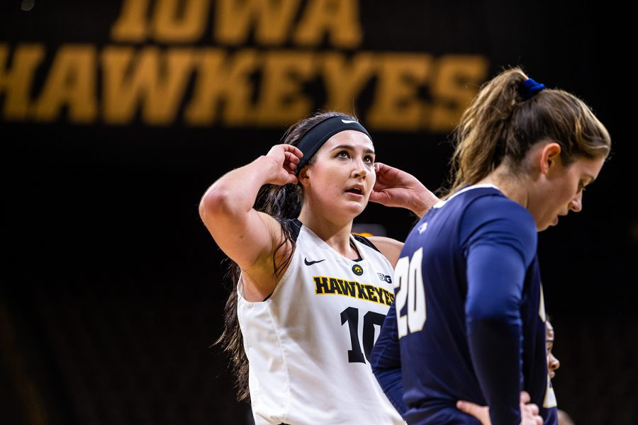 Iowa+forward+Megan+Gustafson+%2310+adjusts+her+headband+during+a+break+in+play+during+a+women%27s+basketball+game+against+Oral+Roberts+University+on+Friday%2C+Nov.+9%2C+2018.+The+Hawkeyes+defeated+the+Golden+Eagles+90-77.+