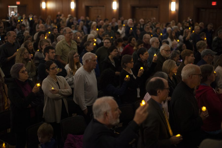 More than 100 people held candles while singing traditional Jewish songs during a vigil for the shootings in Pittsburgh and Louisville in the Iowa Memorial Union on Tuesday, Oct. 30, 2018. Members of the Jewish and African American communities came to mourn the loss of those who were killed in last week's shootings at Kroger and Tree of Life Synagogue.