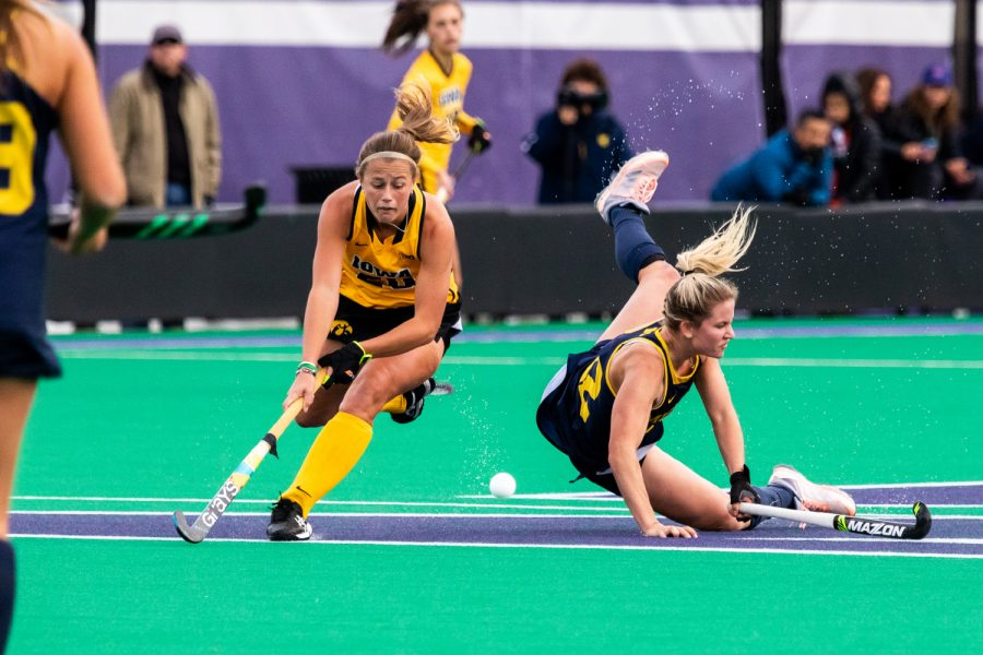 Iowa+midfielder+Sophie+Sunderland+tries+to+control+the+ball+as+a+Michigan+player+crashes+to+the+turf+during+the+Semifinals+in+the+Big+Ten+Field+Hockey+Tournament+at+Lakeside+Field+in+Evanston%2C+IL+on+Friday%2C+Nov.+2%2C+2018.+The+no.+8+ranked+Hawkeyes+defeated+the+no.+7+ranked+Wolverines+2-1.+