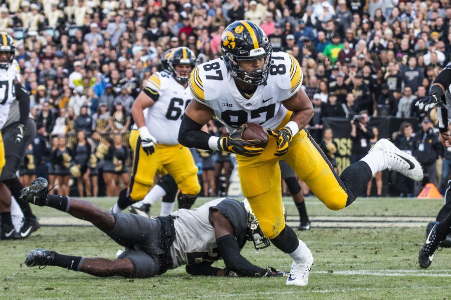 Iowa+tight+end+Noah+Fant+breaks+free+from+an+attempted+tackle+by+Purdue+cornerback+Kenneth+Major+during+the+Iowa%2FPurdue+game+at+Ross-Ade+Stadium+in+West+Lafayette%2C+Ind.+on+Saturday%2C+November+3%2C+2018.+The+Boilermakers+defeated+the+Hawkeyes+38-36.+
