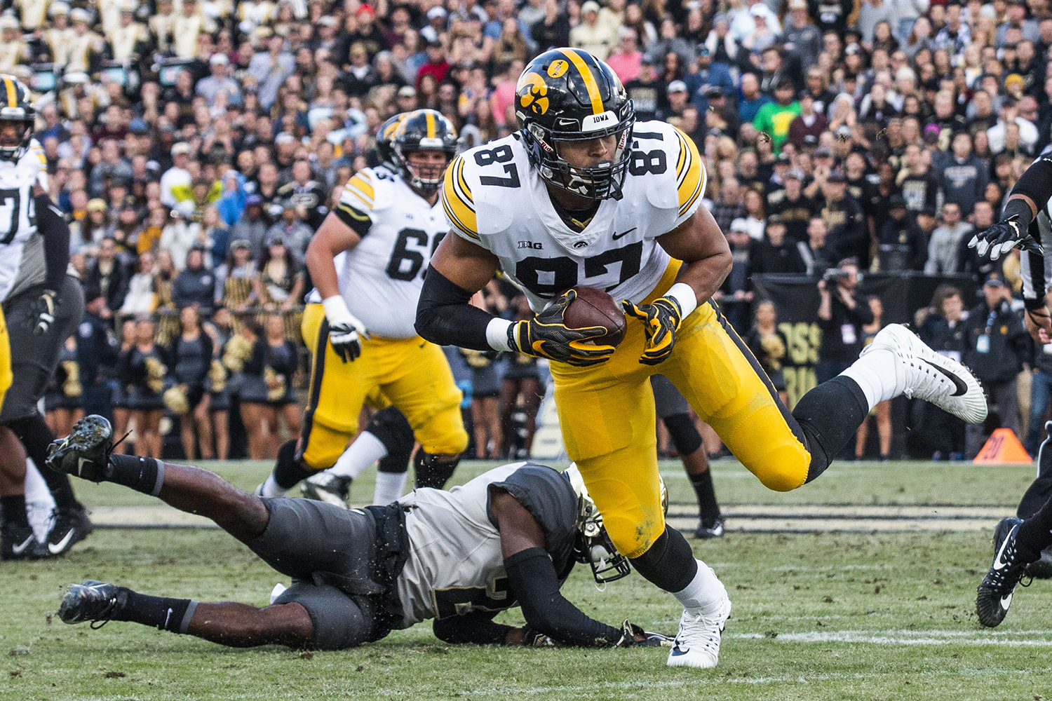 Iowa tight end Noah Fant breaks free from an attempted tackle by Purdue cornerback Kenneth Major during the Iowa/Purdue game at Ross-Ade Stadium in West Lafayette, Ind. on Saturday, November 3, 2018. The Boilermakers defeated the Hawkeyes 38-36.