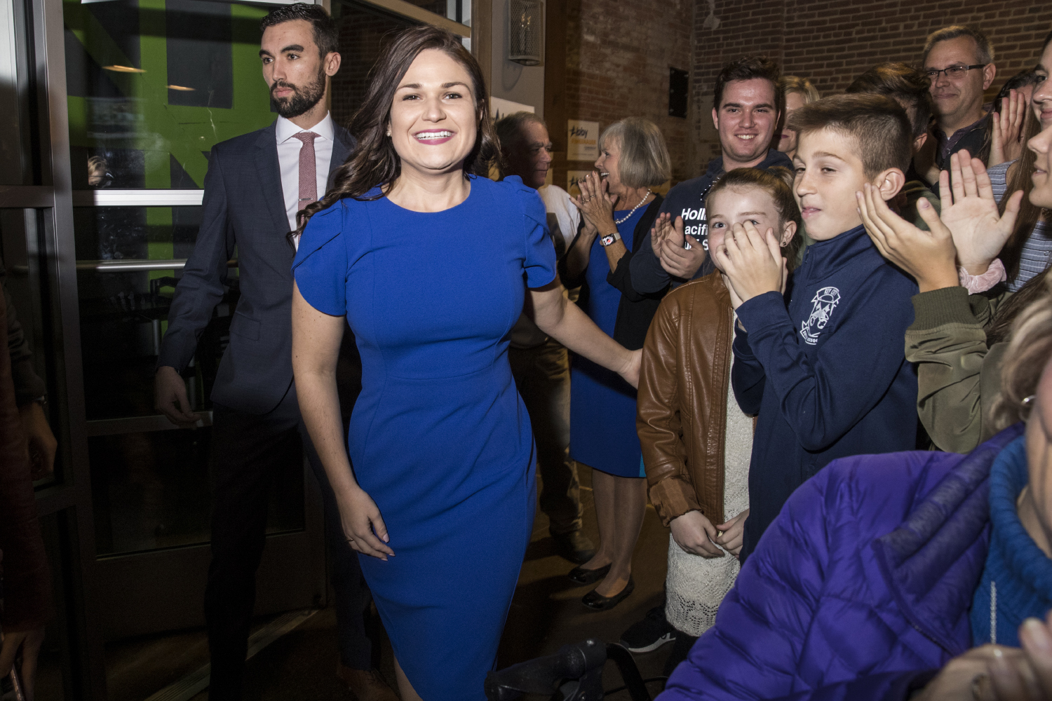 Democratic+candidate+for+Iowa%E2%80%99s+first+congressional+district+Abby+Finkenauer+is+greeted+by+supporters+during+a+watch+party+at+7+Hills+Brewing+Company+in+Dubuque+Iowa+on+Tuesday+Nov.+6%2C+2018.+Finkenauer+defeated+incumbent+Republican+Rod+Blum+and%2C+along+with+Alexandria+Ocasio-Cortez%2C+NY-14%2C+becomes+one+of+the+first+women+under+30+elected+to+the+U.S.+House+of+Representatives.+