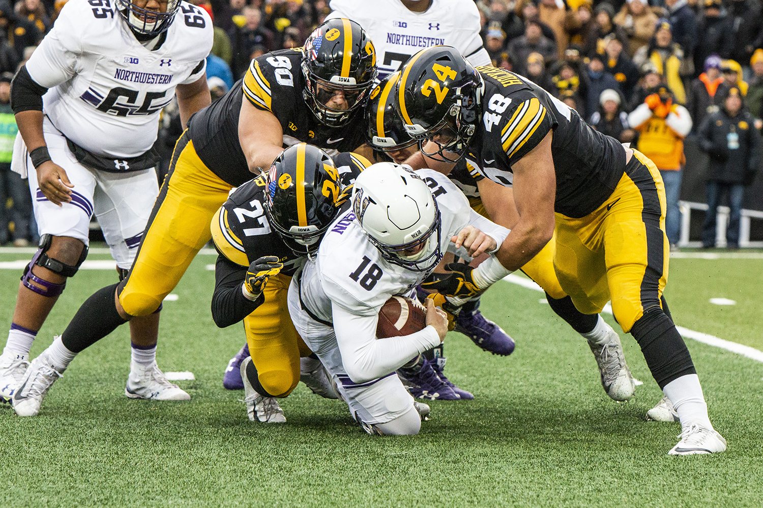 Iowa+defensive+back+Amani+Hooker+%2827%29%2C+defensive+end+Sam+Brincks+%2890%29%2C+and+linebacker+Jack+Hockaday+tackle+Northwestern+quarterback+Clayton+Thorson+during+the+Iowa%2FNorthwestern+game+at+Kinnick+Stadium+on+Saturday%2C+November+10%2C+2018.+The+Wildcats+defeated+the+Hawkeyes+14-10.+%28Katina+Zentz%2FThe+Daily+Iowan%29