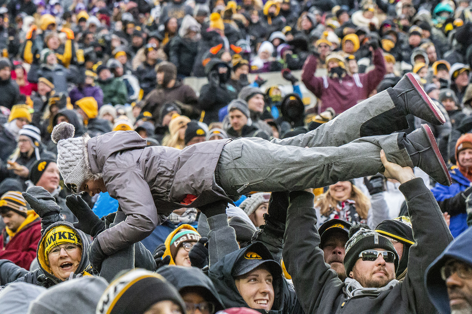 Fans+lift+a+child+for+the+%22Burrito+Lift%22+during+the+Iowa%2FNorthwestern+game+at+Kinnick+Stadium+on+Saturday%2C+November+10%2C+2018.+The+Wildcats+defeated+the+Hawkeyes+14-10.+%28Katina+Zentz%2FThe+Daily+Iowan%29
