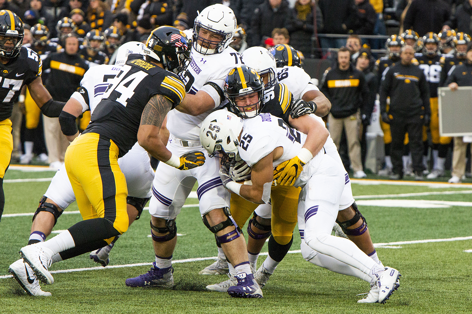 Iowa+defensive+lineman+Brady+Reiff+%2891%29+tackles+Northwestern+running+back+Isaiah+Bowser+%2825%29+during+the+Iowa%2FNorthwestern+game+at+Kinnick+Stadium+on+Saturday%2C+November+10%2C+2018.+The+Wildcats+defeated+the+Hawkeyes+14-10.+%28Katina+Zentz%2FThe+Daily+Iowan%29