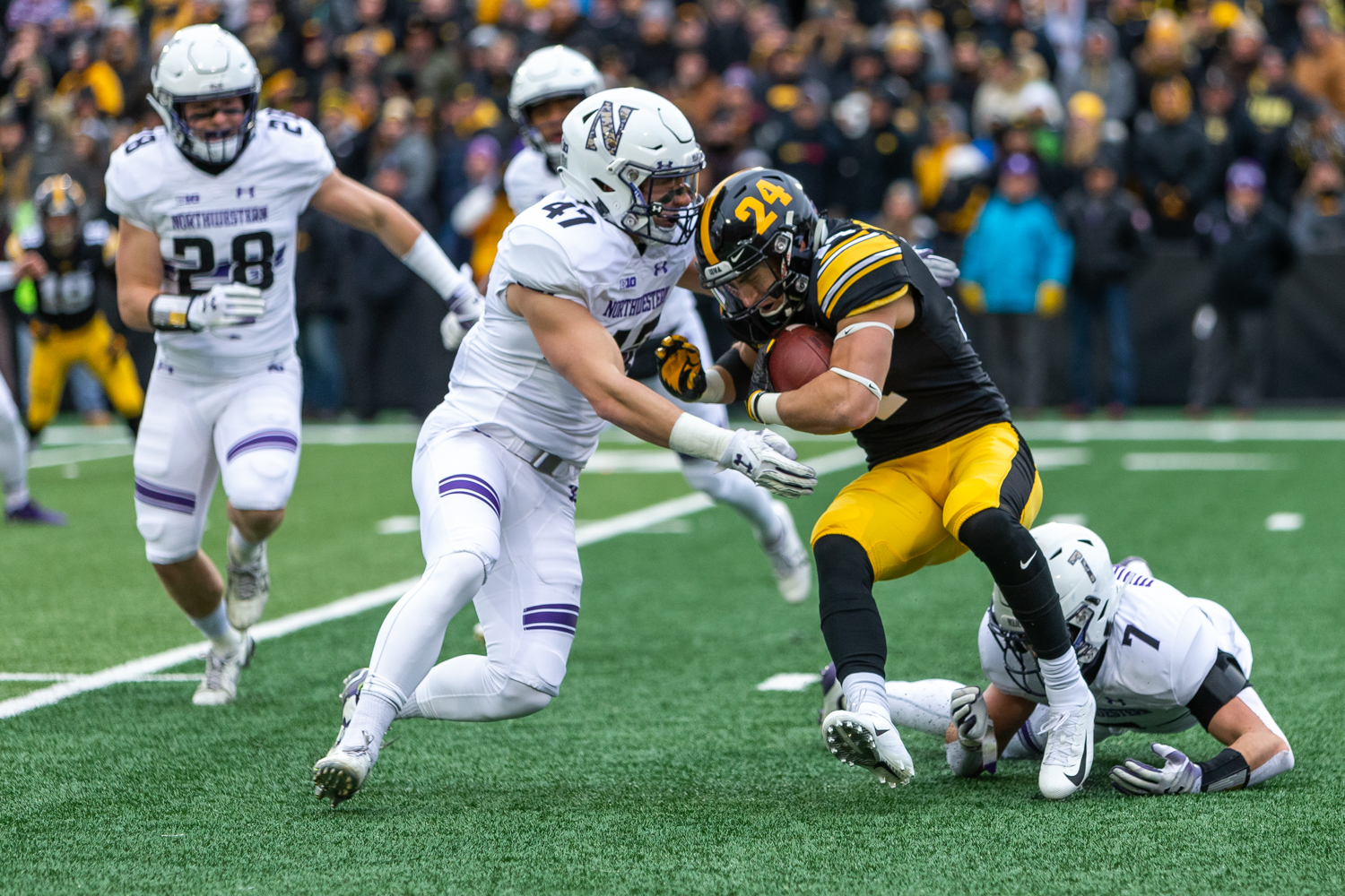 Iowa+wide+receiver+Kyle+Groeneweg+%2314+braces+for+contact+during+a+game+against+Northwestern+University+on+Saturday%2C+Nov.+10%2C+2018+at+Kinnick+Stadium+in+Iowa+City.+The+Wildcats+defeated+the+Hawkeyes+14-10.+%28David+Harmantas%2FThe+Daily+Iowan%29