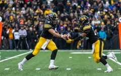 Iowa quarterback Nate Stanley (4) hands off to Iowa running back Ivory Kelly-Martin (21) during a game against Northwestern University on Saturday, Nov. 10, 2018 at Kinnick Stadium. The Wildcats defeated the Hawkeyes 14-10.