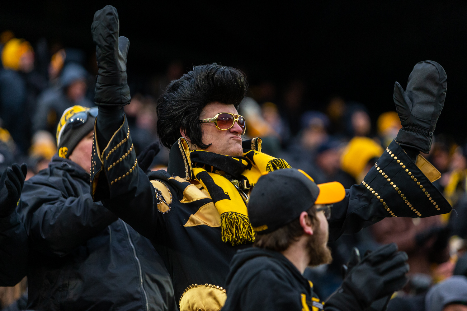 A+fan+dressed+as+Elvis+cheers+from+the+stands+during+a+game+against+Northwestern+University+on+Saturday%2C+Nov.+10%2C+2018+at+Kinnick+Stadium+in+Iowa+City.+The+Wildcats+defeated+the+Hawkeyes+14-10.+%28David+Harmantas%2FThe+Daily+Iowan%29
