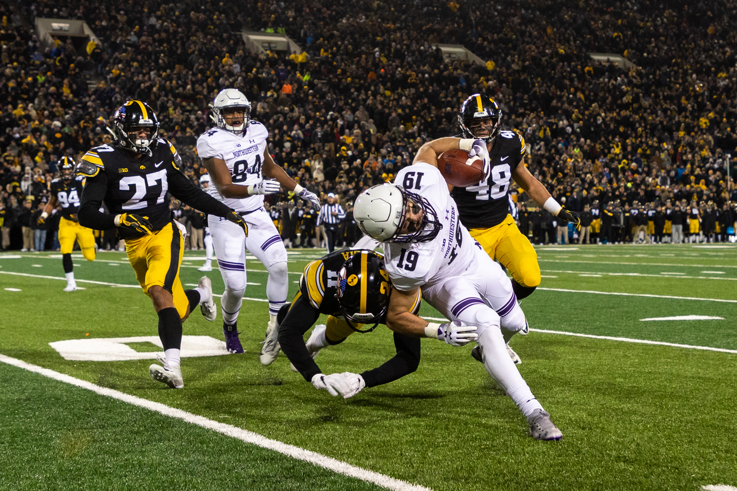 Iowa+defensive+back+Michael+Ojemudia+%2311+tackles+Northwestern+wide+receiver+Riley+Lees+%2319+along+the+sidelines+during+a+game+against+Northwestern+University+on+Saturday%2C+Nov.+10%2C+2018+at+Kinnick+Stadium+in+Iowa+City.+The+Wildcats+defeated+the+Hawkeyes+14-10.+%28David+Harmantas%2FThe+Daily+Iowan%29