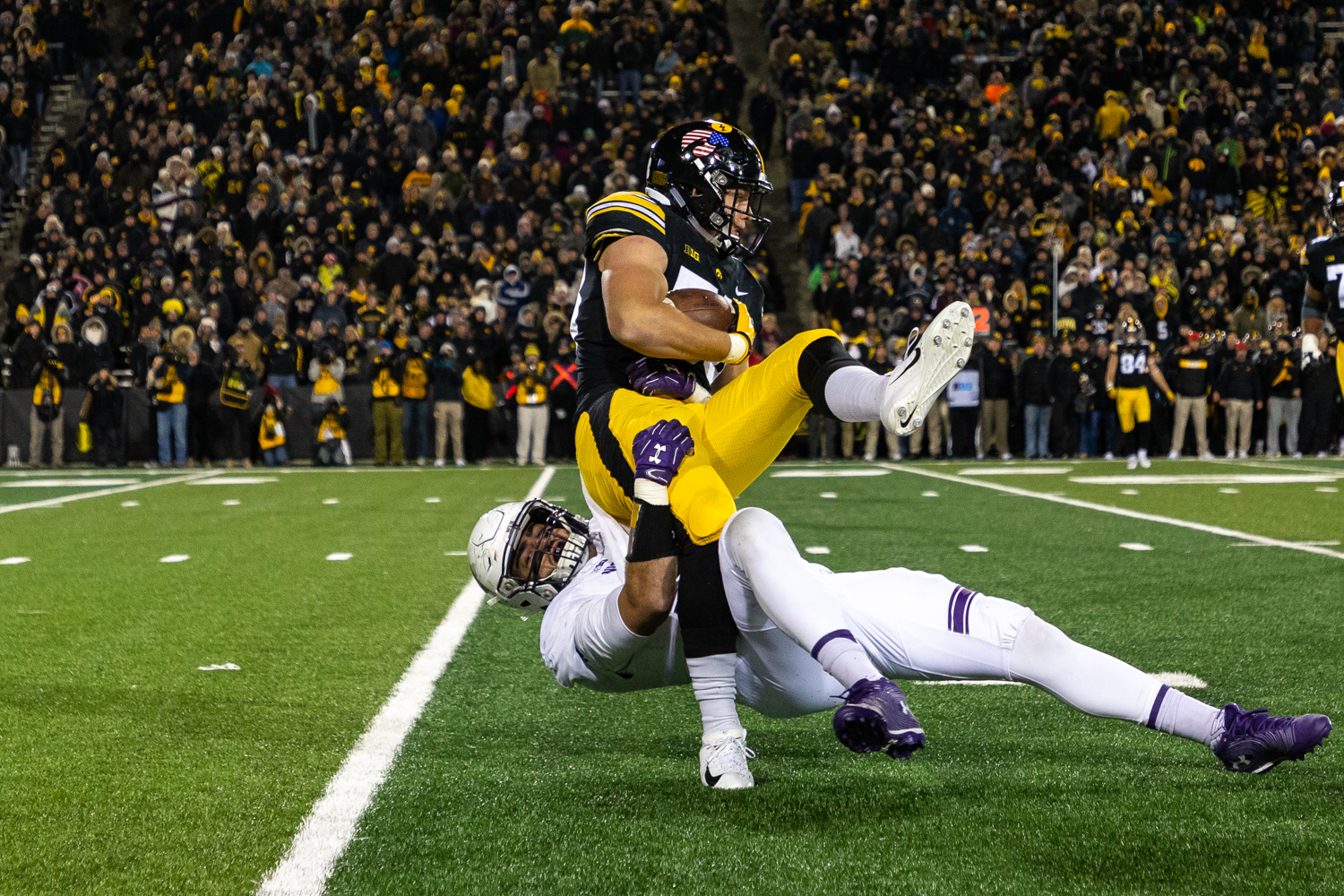 Iowa+tight+end+T.J.+Hockenson+%2338+is+tackled+during+a+game+against+Northwestern+University+on+Saturday%2C+Nov.+10%2C+2018+at+Kinnick+Stadium+in+Iowa+City.+The+Wildcats+defeated+the+Hawkeyes+14-10.+%28David+Harmantas%2FThe+Daily+Iowan%29