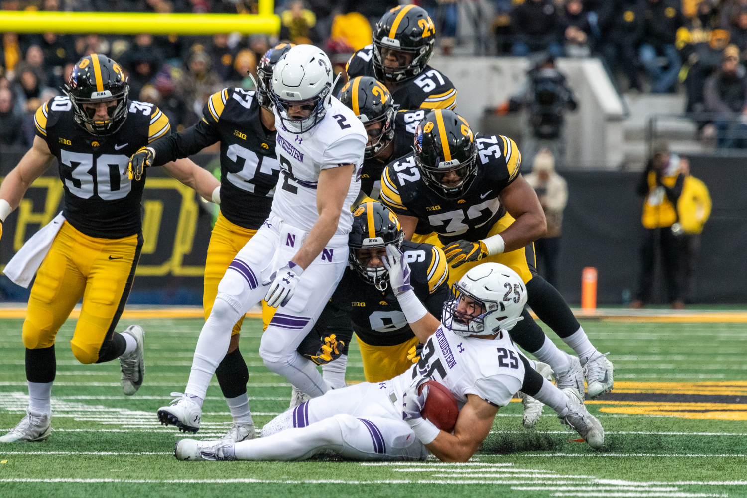 The+Iowa+defense+swarms+to+Northwestern+running+back+Isaiah+Bowser+%2325+during+a+game+against+Northwestern+University+on+Saturday%2C+Nov.+10%2C+2018+at+Kinnick+Stadium+in+Iowa+City.+The+Wildcats+defeated+the+Hawkeyes+14-10.+%28David+Harmantas%2FThe+Daily+Iowan%29