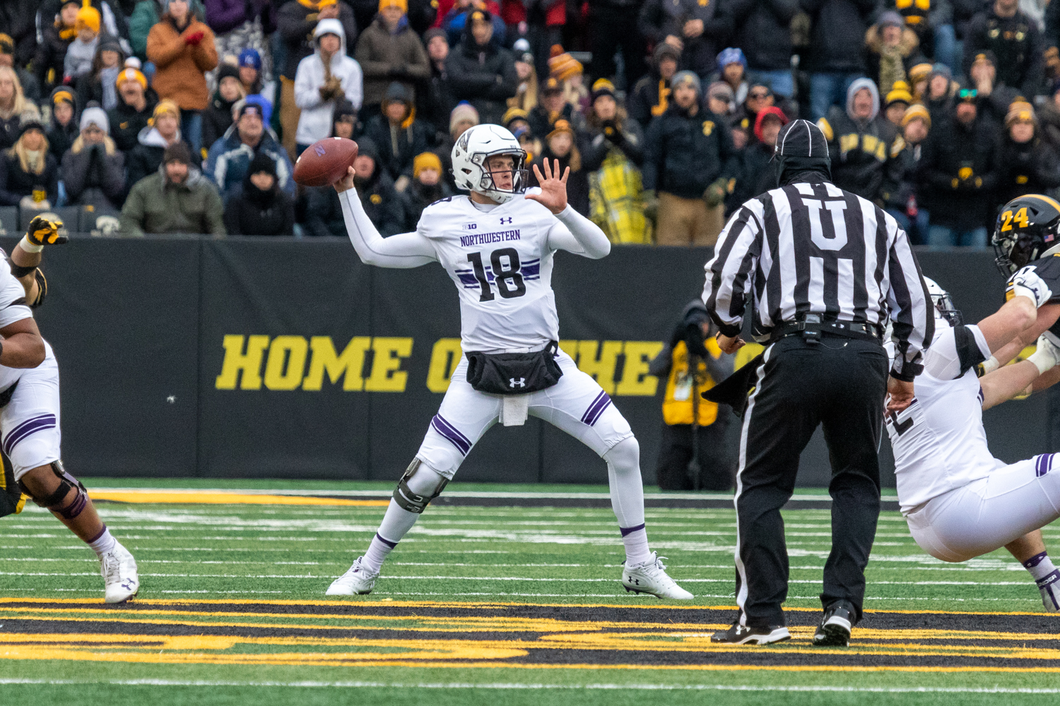 Northwestern+quarterback+Clayton+Thorson+%2318+drops+back+to+pass+during+a+game+against+Iowa+on+Saturday%2C+Nov.+10%2C+2018+at+Kinnick+Stadium+in+Iowa+City.+The+Wildcats+defeated+the+Hawkeyes+14-10.+%28David+Harmantas%2FThe+Daily+Iowan%29
