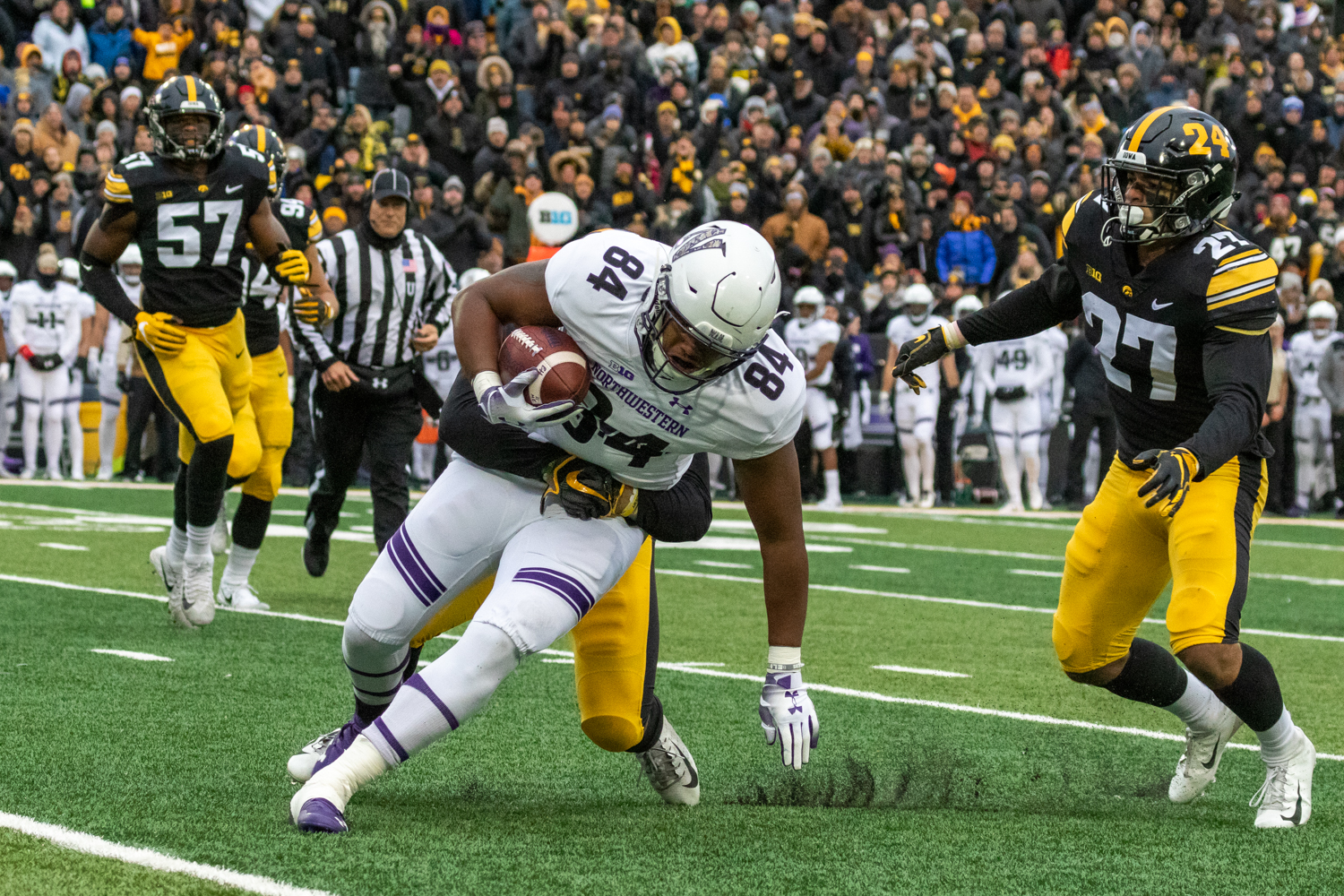 Northwestern+wide+receiver+Cameron+Green+%2384+is+wrapped+up+by+the+Iowa+defense+during+a+game+against+Northwestern+University+on+Saturday%2C+Nov.+10%2C+2018+at+Kinnick+Stadium+in+Iowa+City.+The+Wildcats+defeated+the+Hawkeyes+14-10.+%28David+Harmantas%2FThe+Daily+Iowan%29