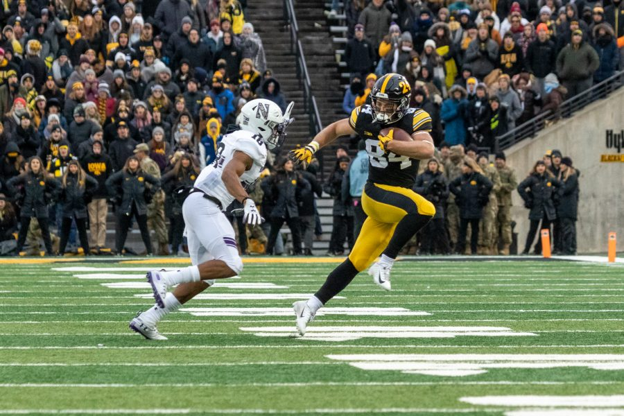 Iowa+wide+receiver+Nick+Easley+%2884%29+runs+away+from+a+defender+during+a+game+against+Northwestern+University+on+Saturday%2C+Nov.+10%2C+2018+at+Kinnick+Stadium+in+Iowa+City.+The+Wildcats+defeated+the+Hawkeyes+14-10.+