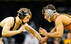 Iowa's #1 ranked Spencer Lee grapples with Princeton's #14 ranked Patrick Glory in a 125-lb weight class bout at Carver-Hawkeye Arena on Friday, Nov. 16, 2018. Lee won via Technical Fall, 17-2. (David Harmantas/The Daily Iowan)